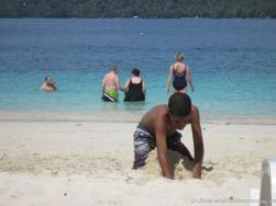 Kid digging a hole at the Cayo Levantado beach.jpg