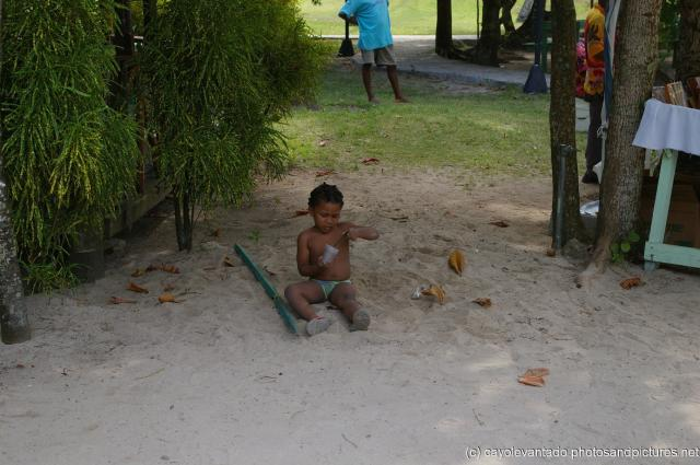 Kid playing with the sand at Cayo Levantado.jpg