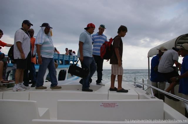 Using tender boat as a bridge to get to another boat leaving Cayo Levantado.jpg