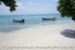 Two boats at a quiet area of Cayo Levantado.jpg