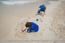 Two kids play in the sand at Cayo Levantado beach.jpg