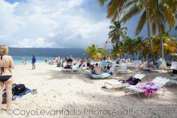 Vacationers at Cayo Levantado beach.jpg