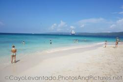 White sand beach with NCL Dawn in the distance at Cayo Levantado.jpg