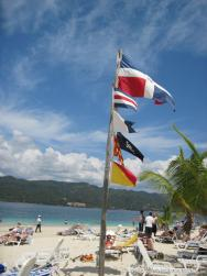 Dominican Republic flag and other flags at Cayo Levantado.jpg